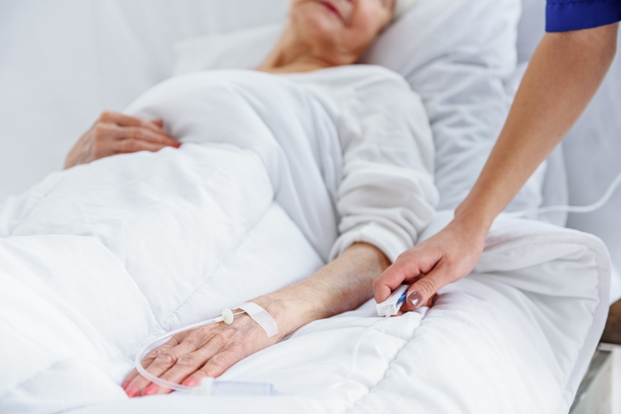 woman in hospital bed with deer tick virus