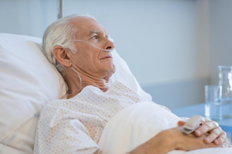 older man in hospital bed with neurological lyme disease