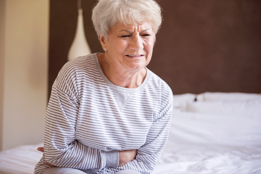woman with stomach pain from lyme disease