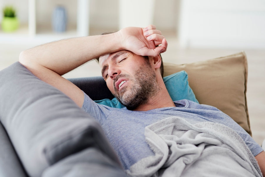 sick man on couch with chronic lyme disease