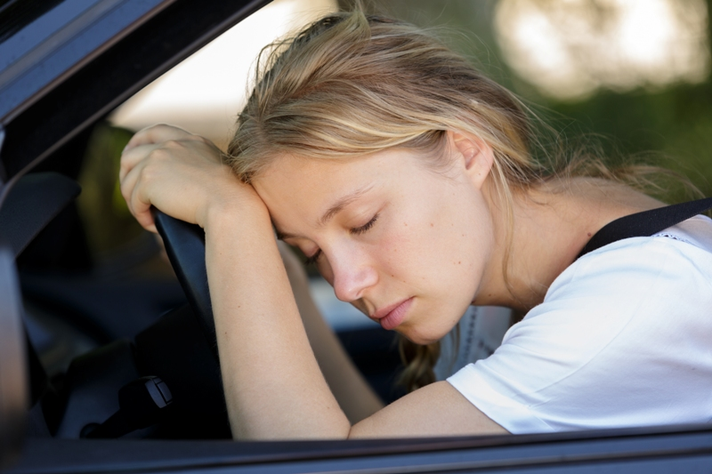 Woman sleeping in car who needs late stage lyme disease treatment