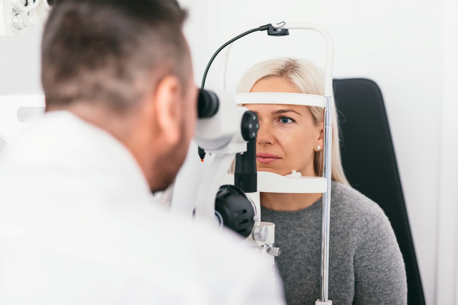 woman with subacute transverse myelitis getting eye exam