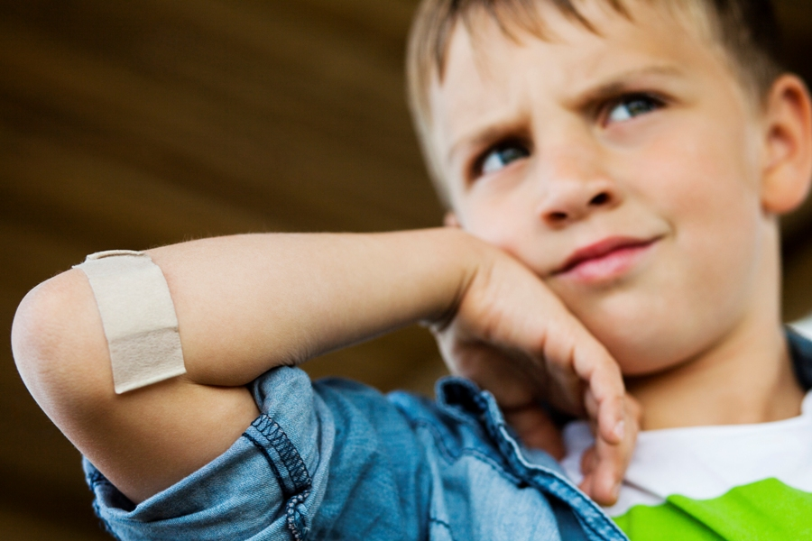 injured toddler with Lyme disease and bandaid on arm