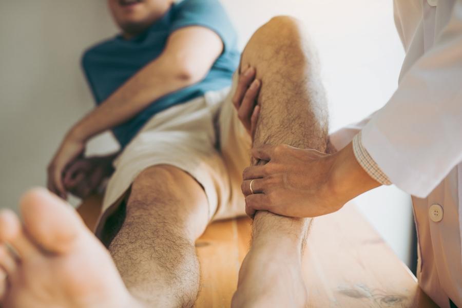 man with lyme disease having leg bone examined by doctor